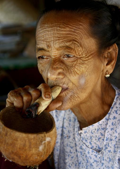 Elderly Woman Smoking Cigar, Bagan, Myanmar