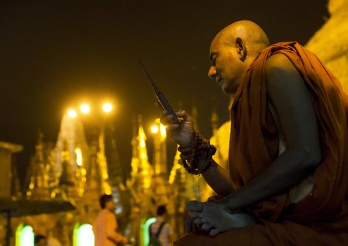 Monk Calling On A Mobile Phone At Shwedagon Pagoda, Yangon, Myanmar