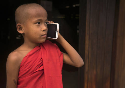 Novice Monk Calling On A Mobile Phone  In Nat Taung Kyaung Monastery, Bagan, Myanmar
