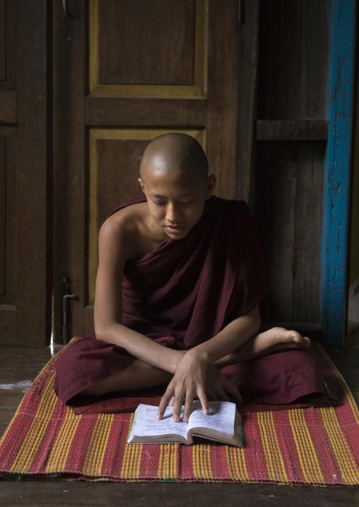 Young Novice Reading A Book, Mrauk U, Myanmar
