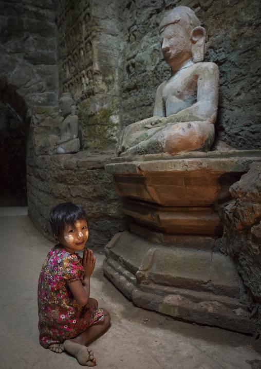 Little Girl Praying Inside Kothaung Temple, Mrauk U, Myanmar