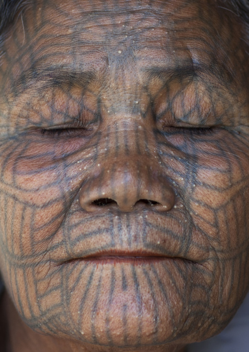 Tribal Chin Woman With Spiderweb Tattoo On The Face And Closed Eyes, Mrauk U, Myanmar