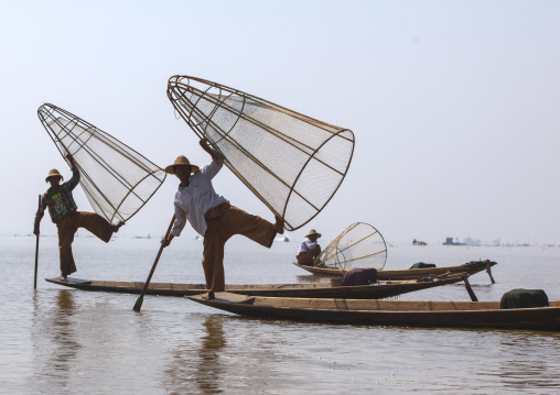Traditional Fishermen With Fish Trap In Boat, Inle Lake, Myanmar