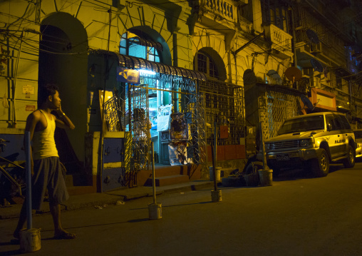 Man Calling On The Phone In The Old Colonial Dictrict, Yangon, Myanmar