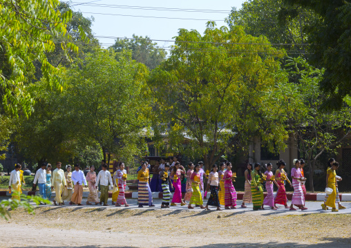 Women Walking To The Temple With Offerings For A Novitiation Ceremony, Bagan,  Myanmar