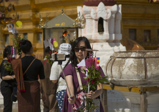 Woman Taking A Picture With A Selfie Stick In A Temple, Bagan, Myanmar
