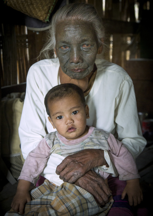Tribal Chin Woman From U Pu Tribe With Tattoo On The Face Holding Her Little Son, Kanpelet, Myanmar
