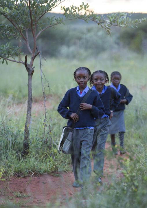 Kids On The Way To Africat Foundation School, Okonjima, Namibia