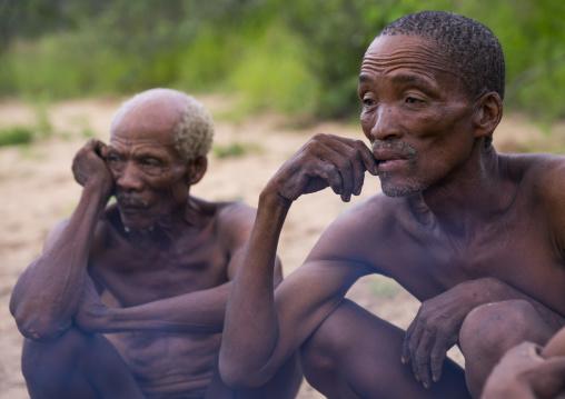 Bushmen Around A Fire In A Traditional Village, Tsumkwe, Namibia