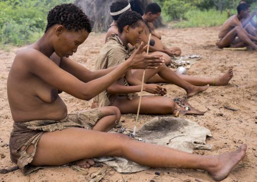 Bushman Women Making Necklaces With Ostrich Eggs Shells, Tsumkwe, Namibia