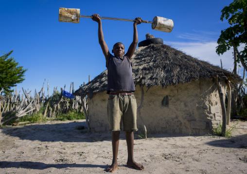 Young Man Exercising With Barbells, Ondangwa, Namibia