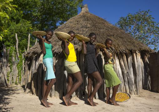Ovambo Girls Holding A Basket Of Seeds, Ondangwa, Namibia