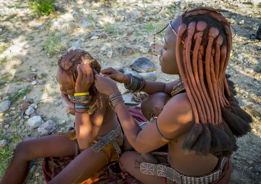 Himba Woman Making Dreadlocks On Her Friend, Epupa, Namibia