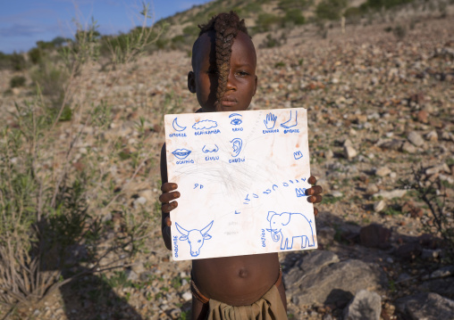 Himba Child Holding A Paper With Himba Words, Epupa, Namibia