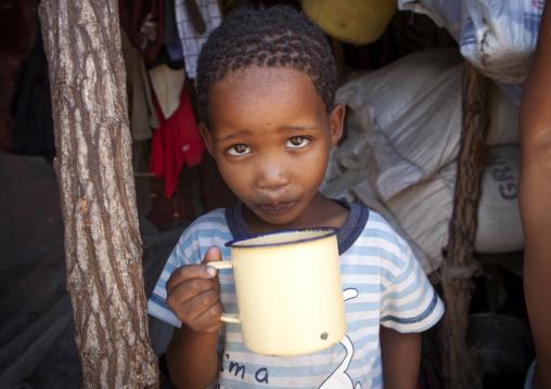 Bushman Child Boy Drinking Milk, Tsumkwe, Namibia