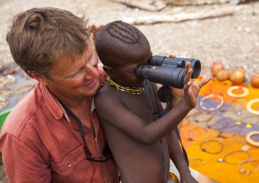 Himba Child Looking Thru Binoculars, Epupa, Namibia