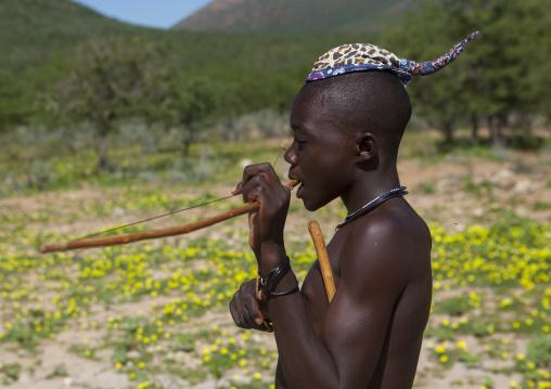 Himba Man Playing Bow Instrument, Epupa, Namibia