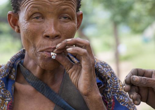 Bushman Woman Smoking, Tsumkwe, Namibia