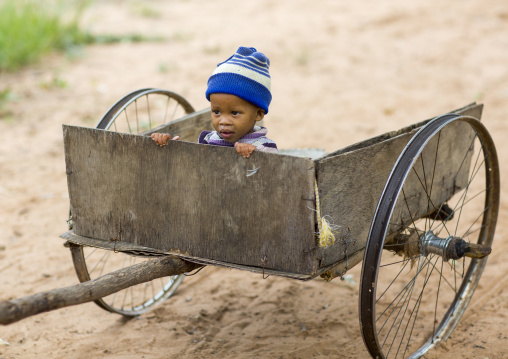 Bushman Child Boy In A Cart, Tsumkwe, Namibia