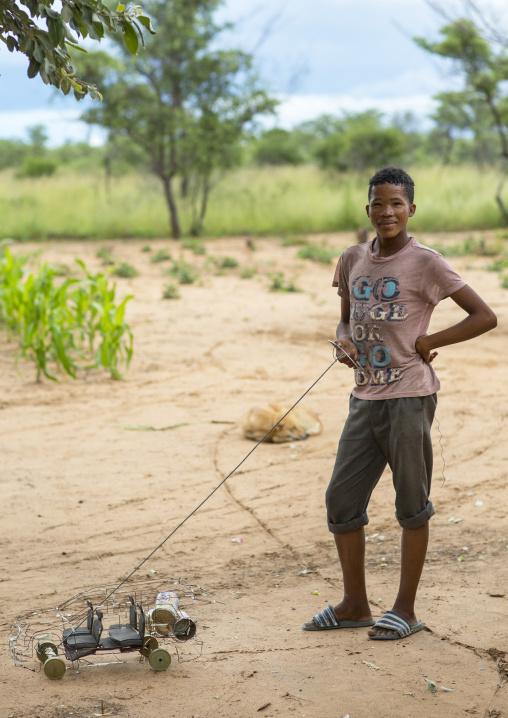 Bushman Child With A Car Toy, Tsumkwe, Namibia