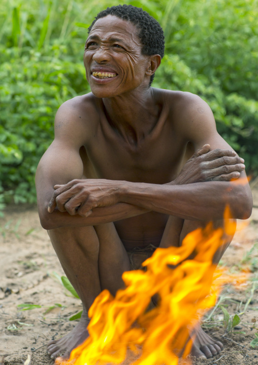 Busman In Front Of A Fire, Tsumkwe, Namibia