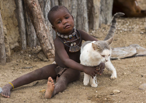 Himba Child Playing With A Cat, Epupa, Namibia
