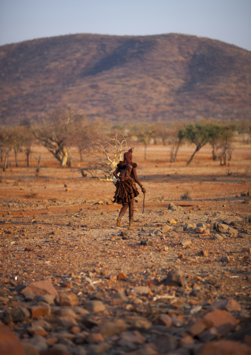 Himba Woman Walking In The Bush, Epupa, Namibia