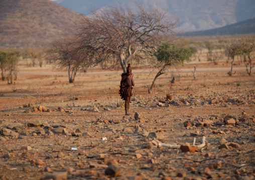 Himba Woman Carrying Her Baby On Her Back, Okapale Area, Namibia
