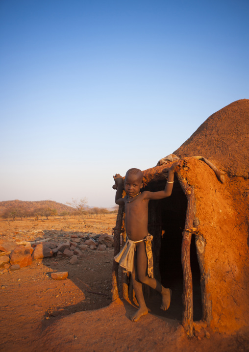 Girl Of Himba Tribe Standing In Door Of Shack, Epupa, Namibia