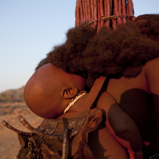 Himba Baby On The Back Of His Mother, Okapale Area, Namibia