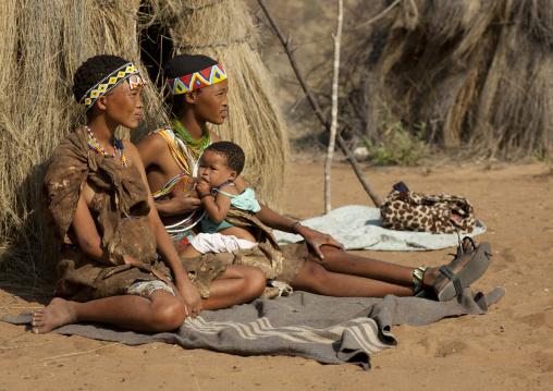 San Woman Breast Feeding Her Baby, Namibia