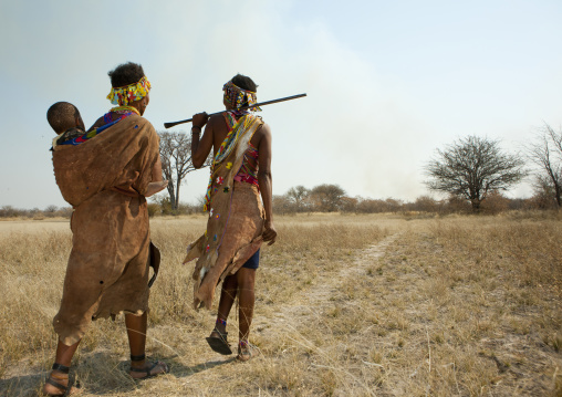 San Women Walking In The Bush With A Baby, Namibia