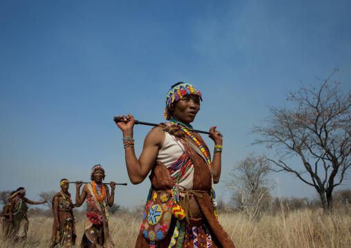 Group Of San Women Walking In The Bush, Namibia
