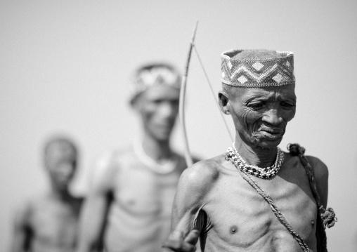 San Hunters Walking In The Bush, Namibia