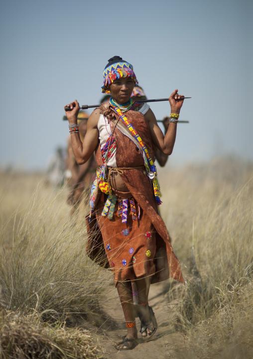 San Woman Walking In The Bush, Namibia