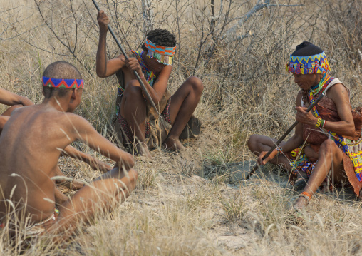 San Women Digging To Find Water Tubers, Namibia