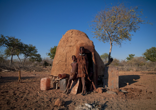 Himba Girls Leaning On A Hut, Karihona Village, Ruacana Area, Namibia