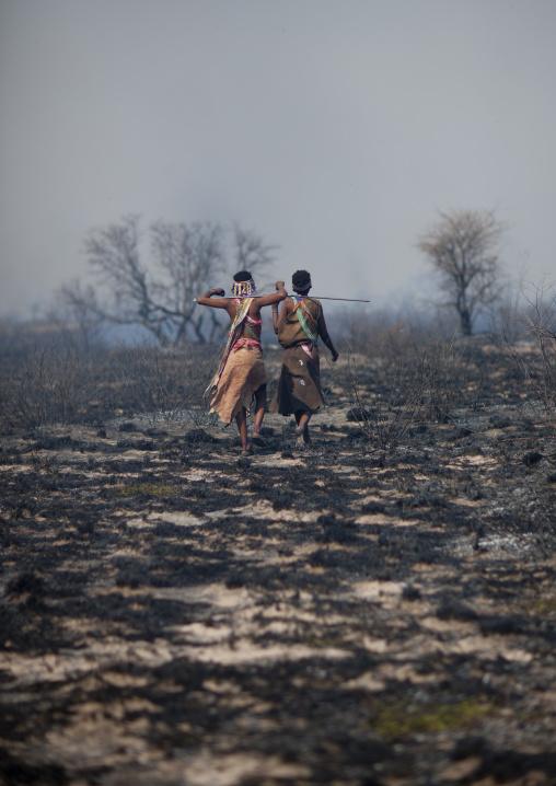 San Women Walking In The Bush After A Fire, Namibia