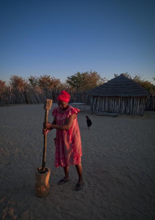 Ovambo Woman Grinding, Ruacana Area, Namibia