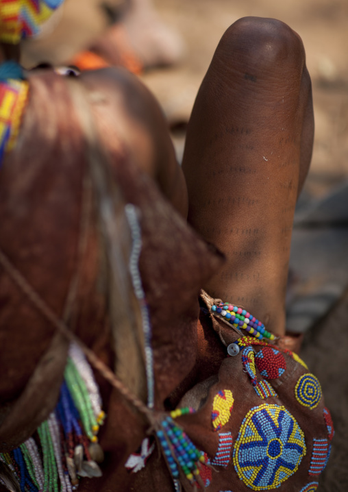 San Woman With Scarifcations On The Legs And A Bag Decorated With Beads, Namibia