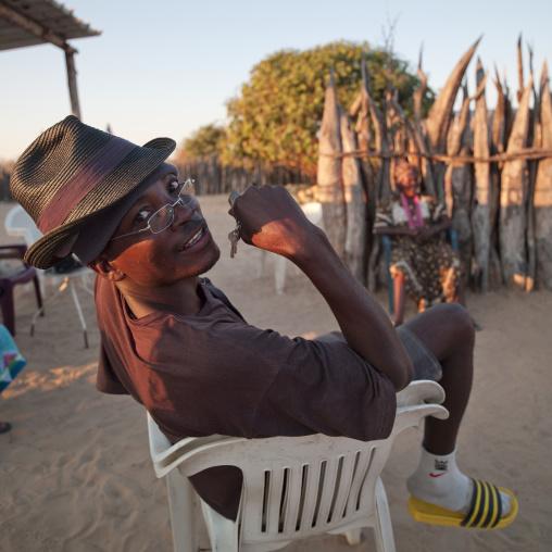 Ovambo Man On A Plastic Chair, Ruacana Area, Namibia