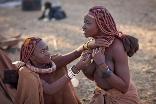 Himba Women Dressing Up, Karihona Village, Ruacana Area, Namibia