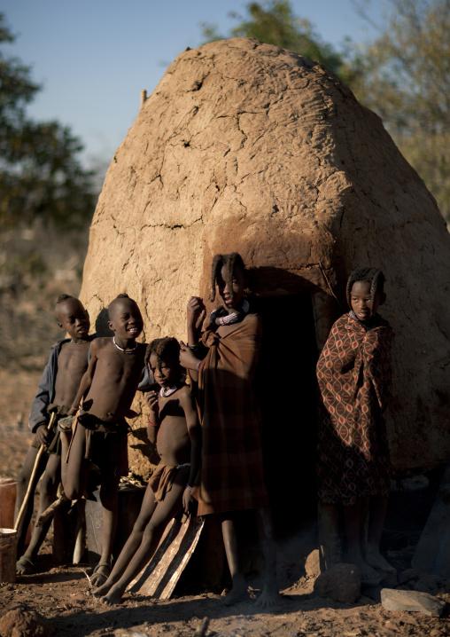Himba Kids Leaning On A Hut, Karihona Village, Ruacana Area, Namibia