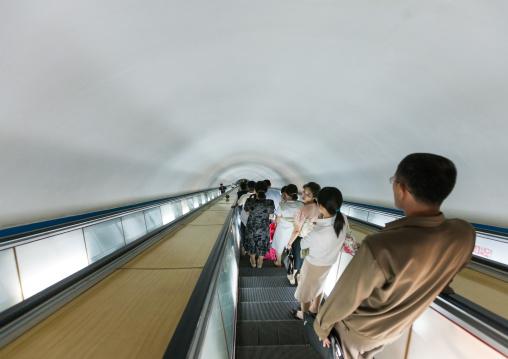 North Korean people using escalator leading to the subway station, Pyongan Province, Pyongyang, North Korea