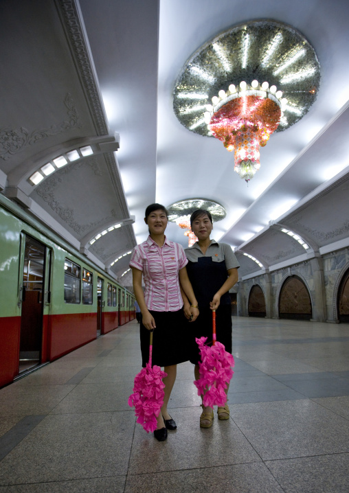 North Korean women with plastic flowers for a parade in puhung station on Chollima line, Pyongan Province, Pyongyang, North Korea