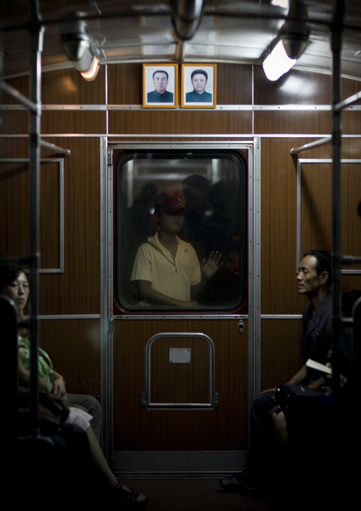 Official portraits of the Dear Leaders in a subway wagon, Pyongan Province, Pyongyang, North Korea