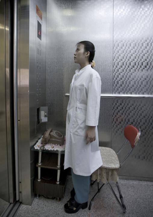North Korean doctor in an elevator in a maternity, Pyongan Province, Pyongyang, North Korea