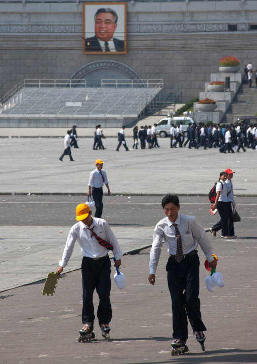 North Korean boys with rollers on Kim il Sung square, Pyongan Province, Pyongyang, North Korea
