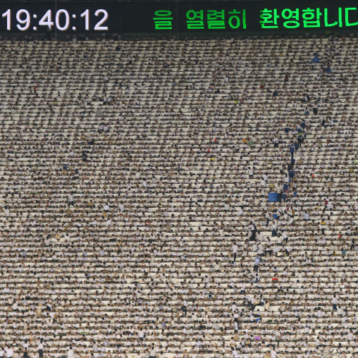 Children used to make human pixels by holding up colored boards during Arirang mass games in may day stadium, Pyongan Province, Pyongyang, North Korea