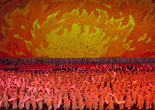 North Korean dancers in front of a sky of fire made by children pixels holding up colored boards during Arirang mass games in may day stadium, Pyongan Province, Pyongyang, North Korea